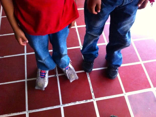 Adults and children must remove their shoe laces before being deported.